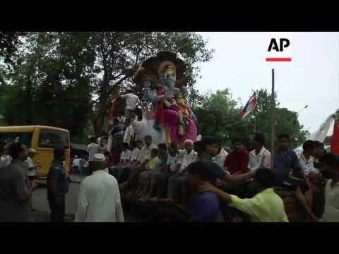 Thousands bid traditional farewell to elephant-headed Hindu God at the end of festival