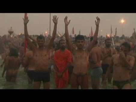 Hindu festival: Millions take a dip in the Ganges river