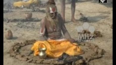 India News - Hindu priests in northern India practice fire ritual to achieve salvation