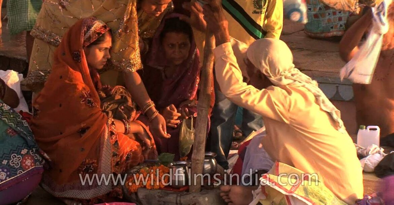 Priest performing Hindu rituals with new born baby and his family during Maha shivratri at varanasi